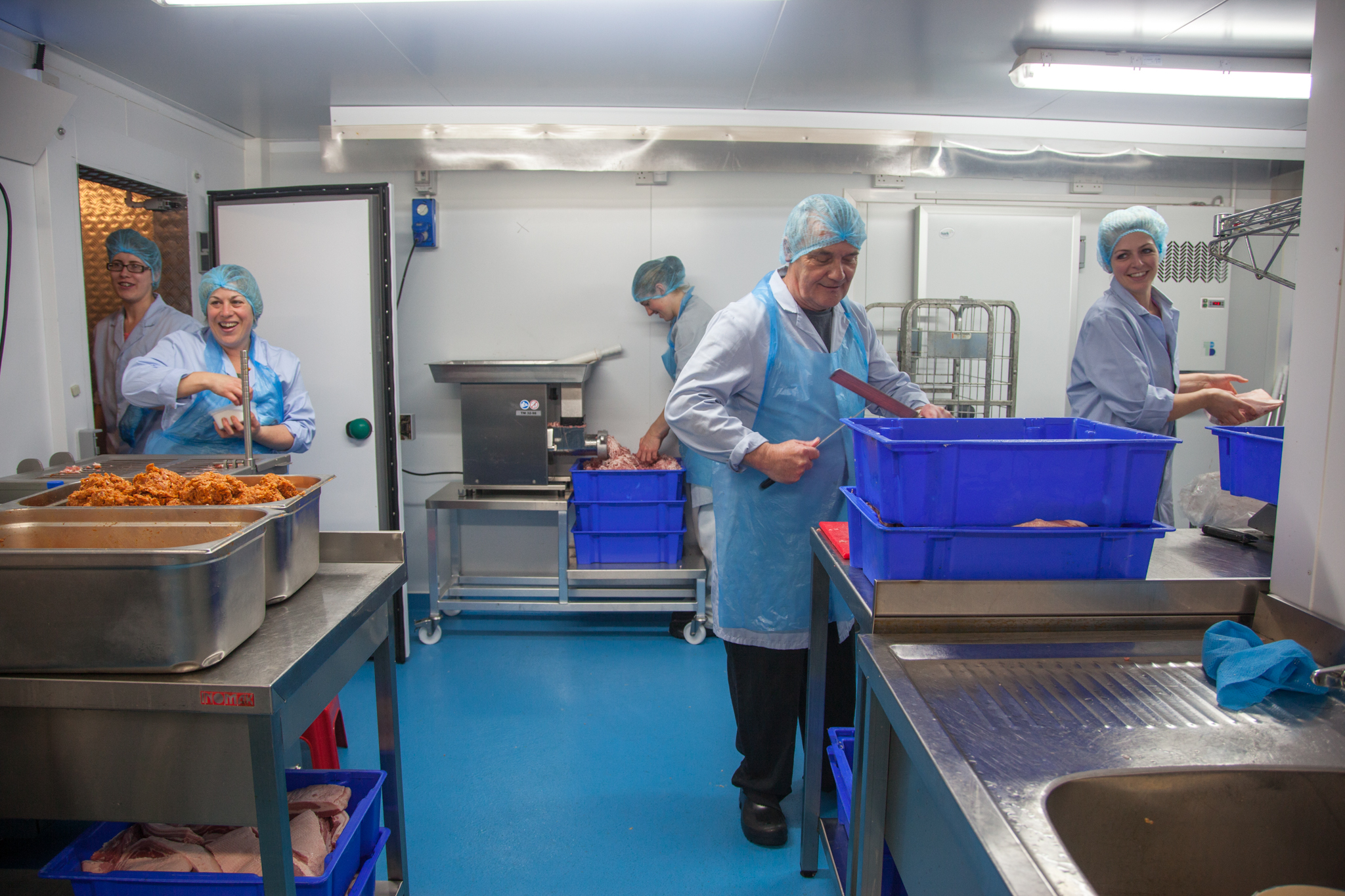 The team at Deli Farm all working in their small factory, in order produce some of their special christmas Salami. Delabole, Cornwall.  17.11.15