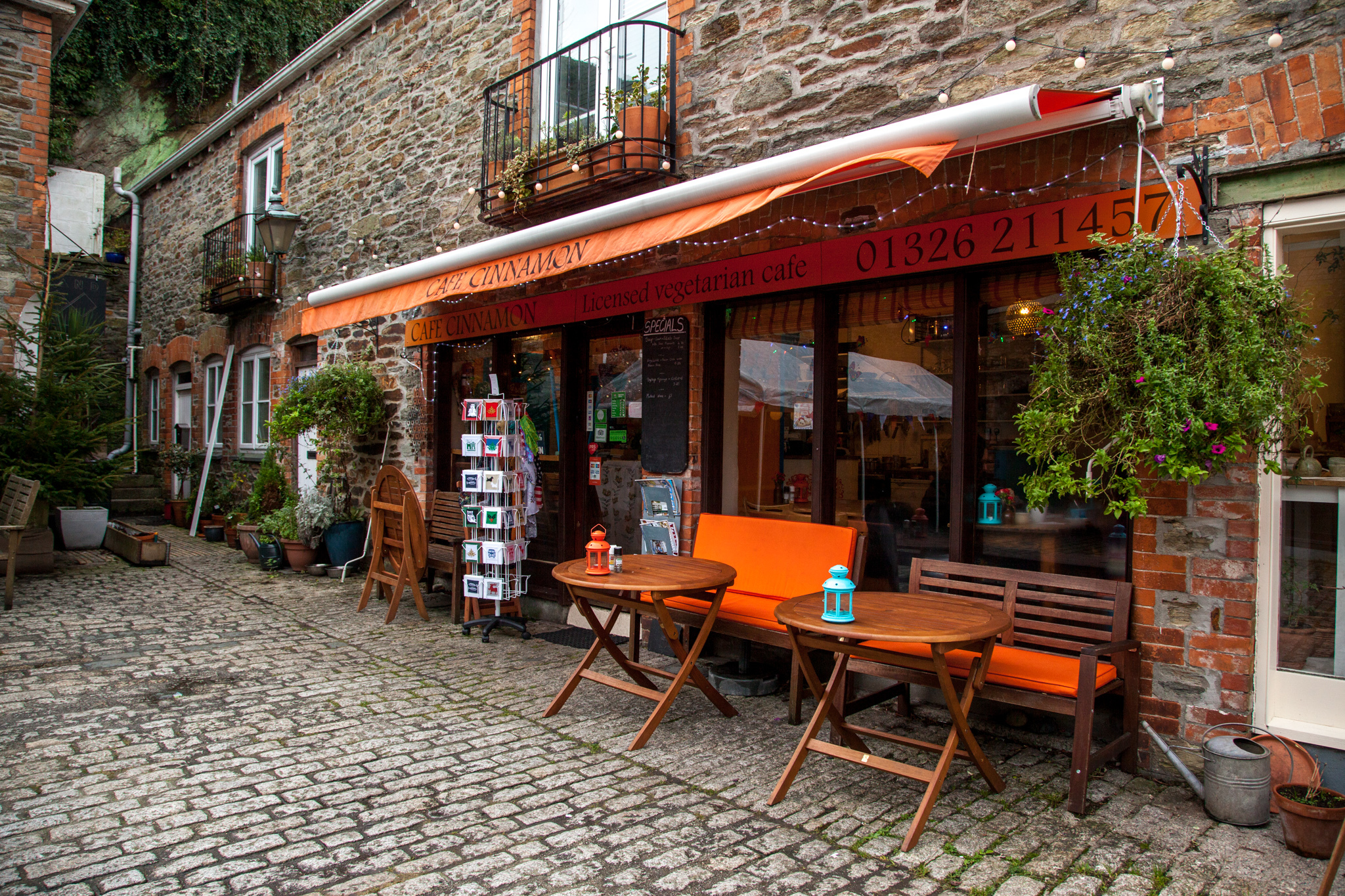 A view of the outside of the Cafe, including its outside seating and its gorgeous courtyard area in the centre of Falmouth, Cornwall. [DATE]