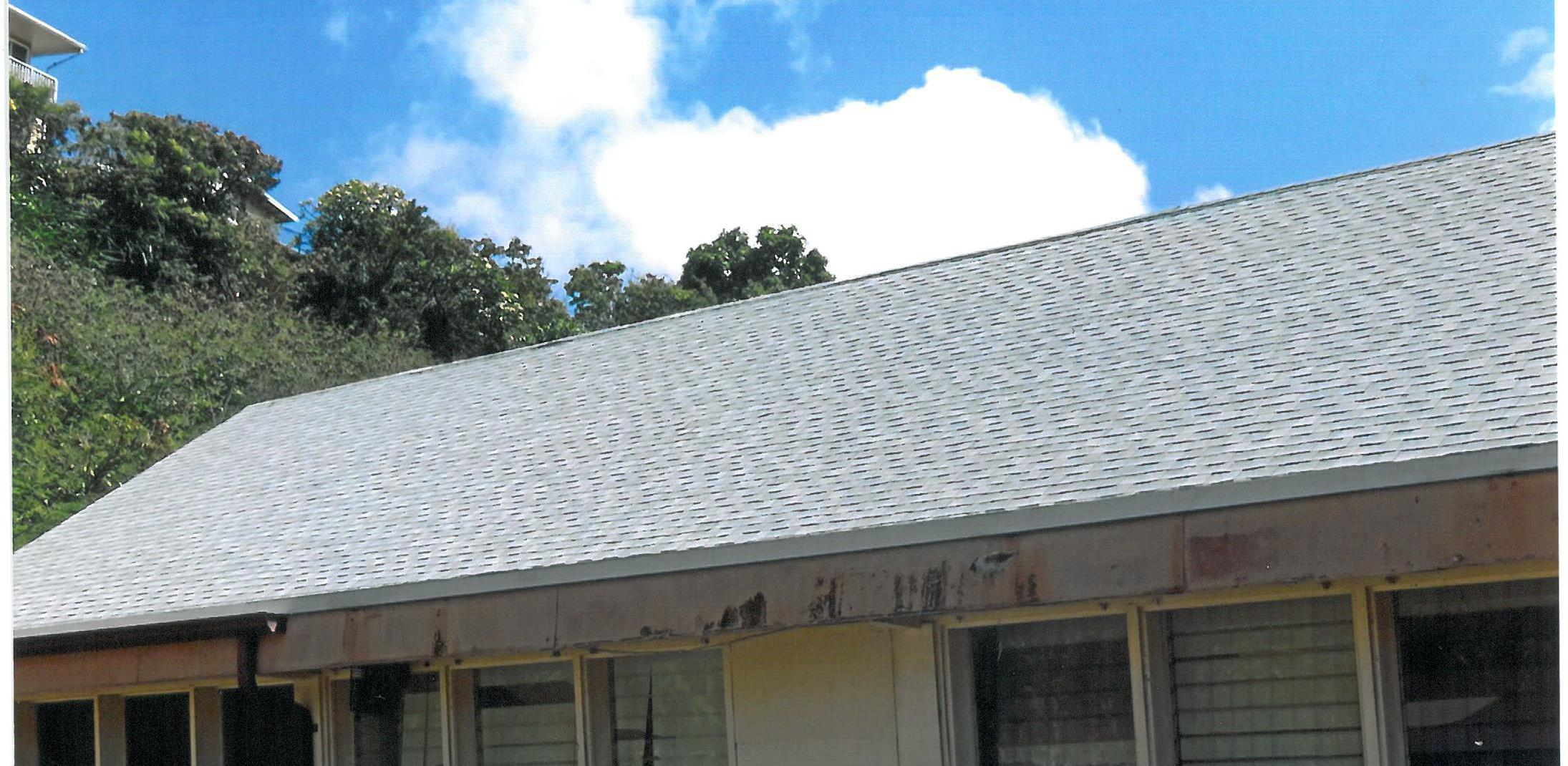 Professional roof contractors working on a roof in Honolulu, HI