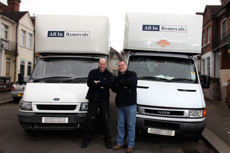 Two of our team standing in front of their vans