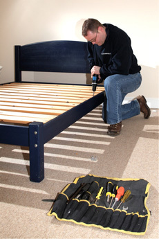 A man putting a bed together