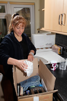 A lady opening a packing box