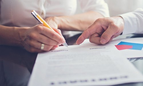 A man signing on a document