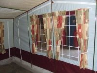 a tent with curtains