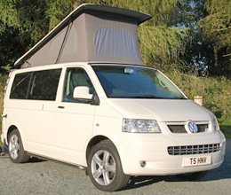 A white van with tent roof