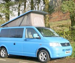 A blue van with tent roof