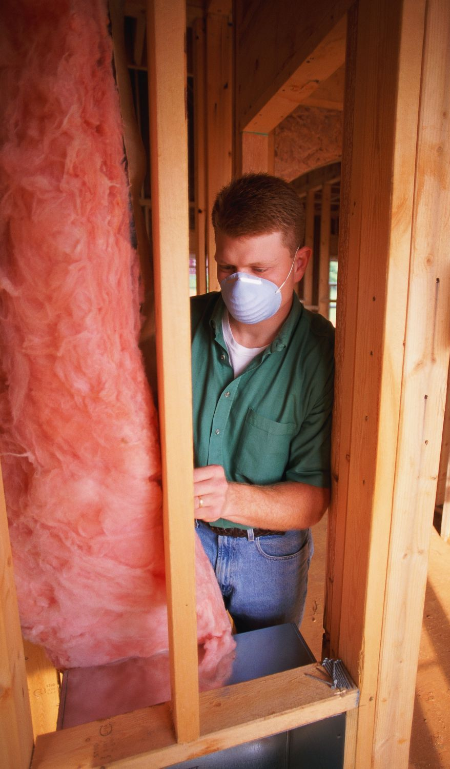 man providing insulation and ventilation services in the Rochester, NY