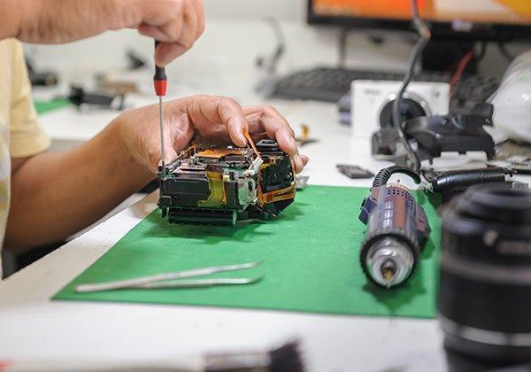 Technician repairing camera
