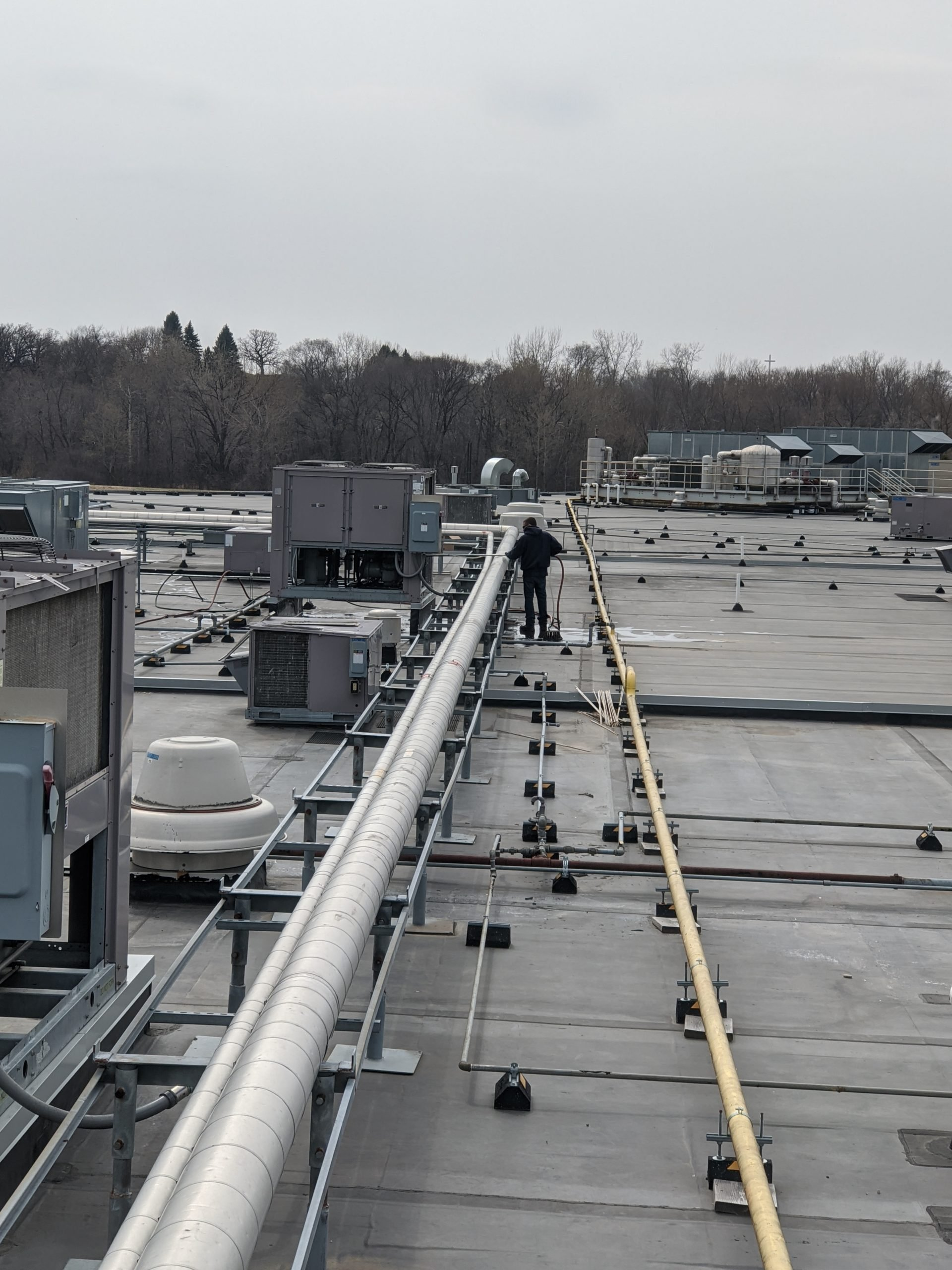 Worker on the Rooftop— Lakeville, MN — G&B Environmental
