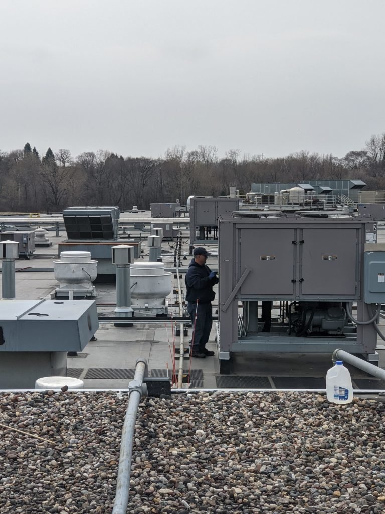 Man Cleaning Air Condition — Lakeville, MN — G&B Environmental