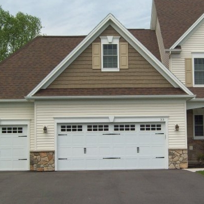 house with white garage doors