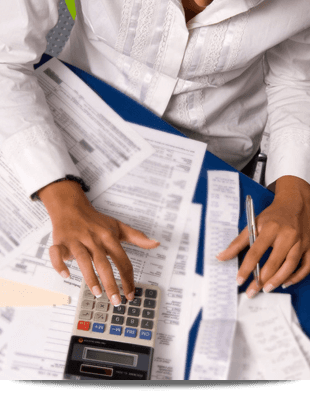 Female accountant inputting some figures in a calculator