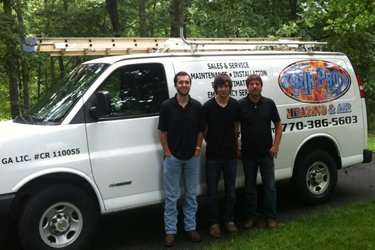 Air Pro team standing in front of their truck