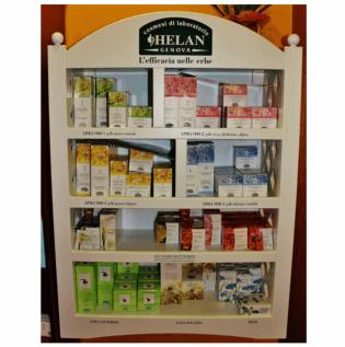 Una vetrina bianca con dei prodotti e sul mobile scritta Helan Genova