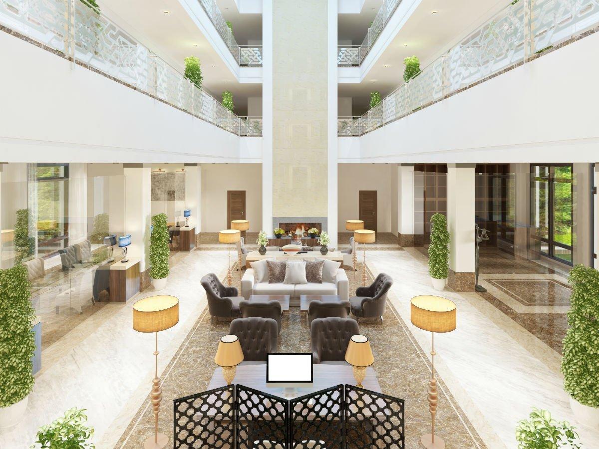Una hall un albergo con poltrone e lampade