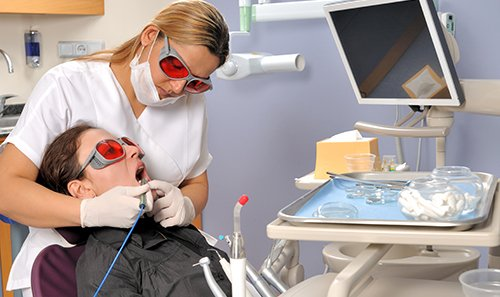 Woman getting cosmetic dentistry services in Orange, CT