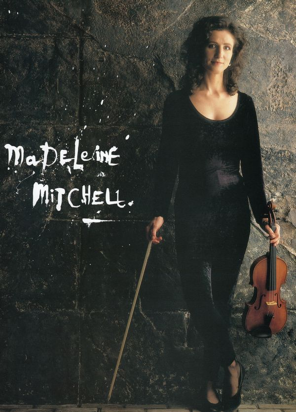 madeleine mitchell against a stone wall