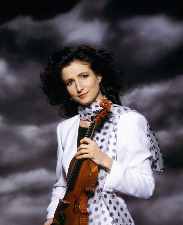 madeleine holding a violin on clouds background