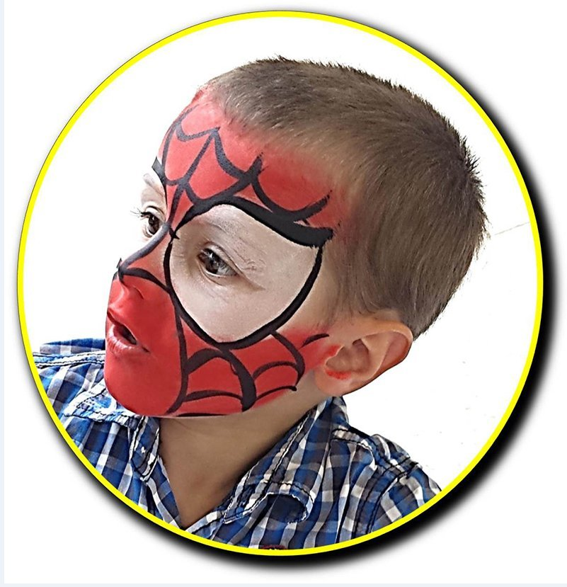Boy with spiderman face paint