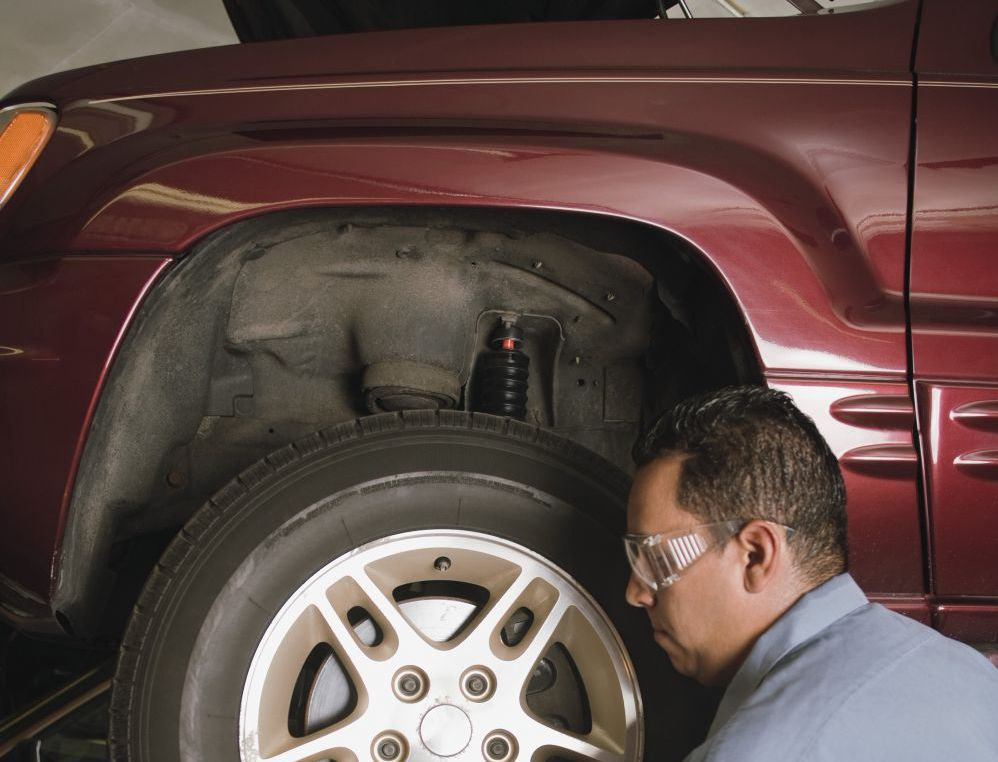 Removing a tire at our collision center in Jackson, CA