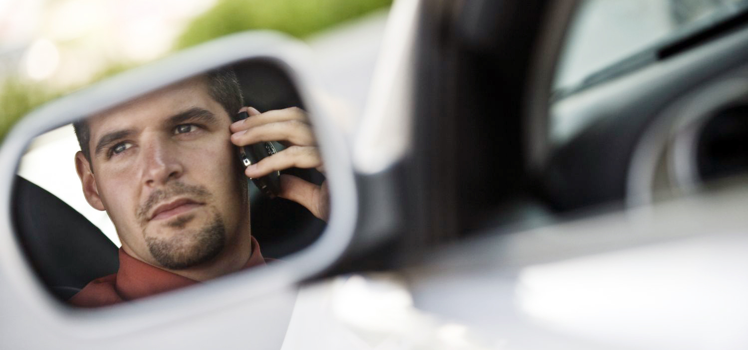 Man calling one of our auto body repair specialists in Jackson, CA