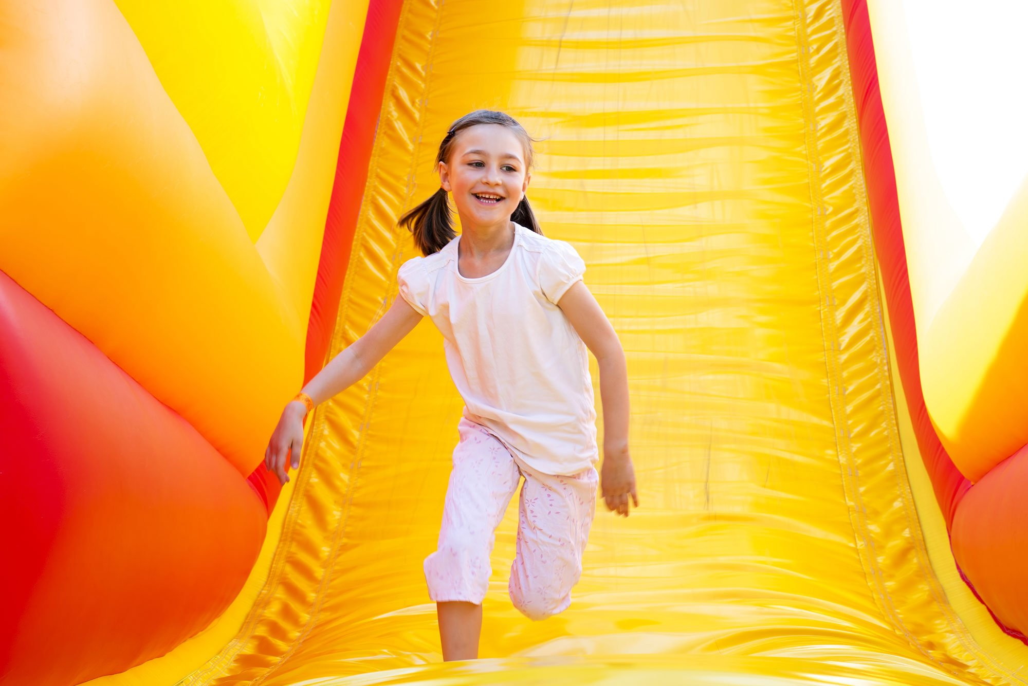 Girl playing on inflatable slide