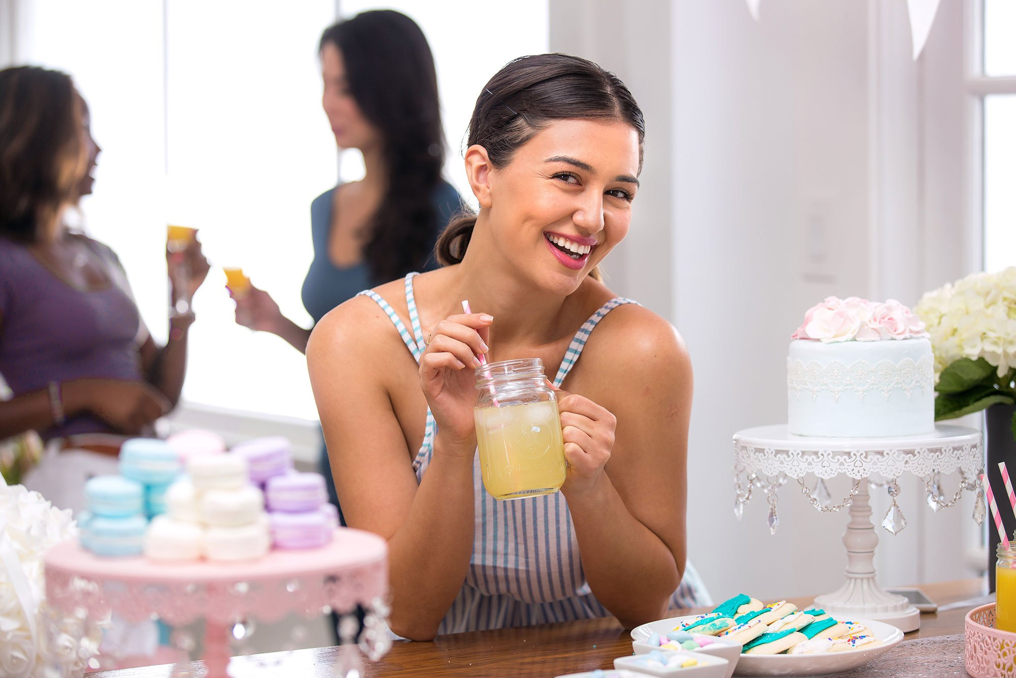 Woman having a drink at a bridal shower