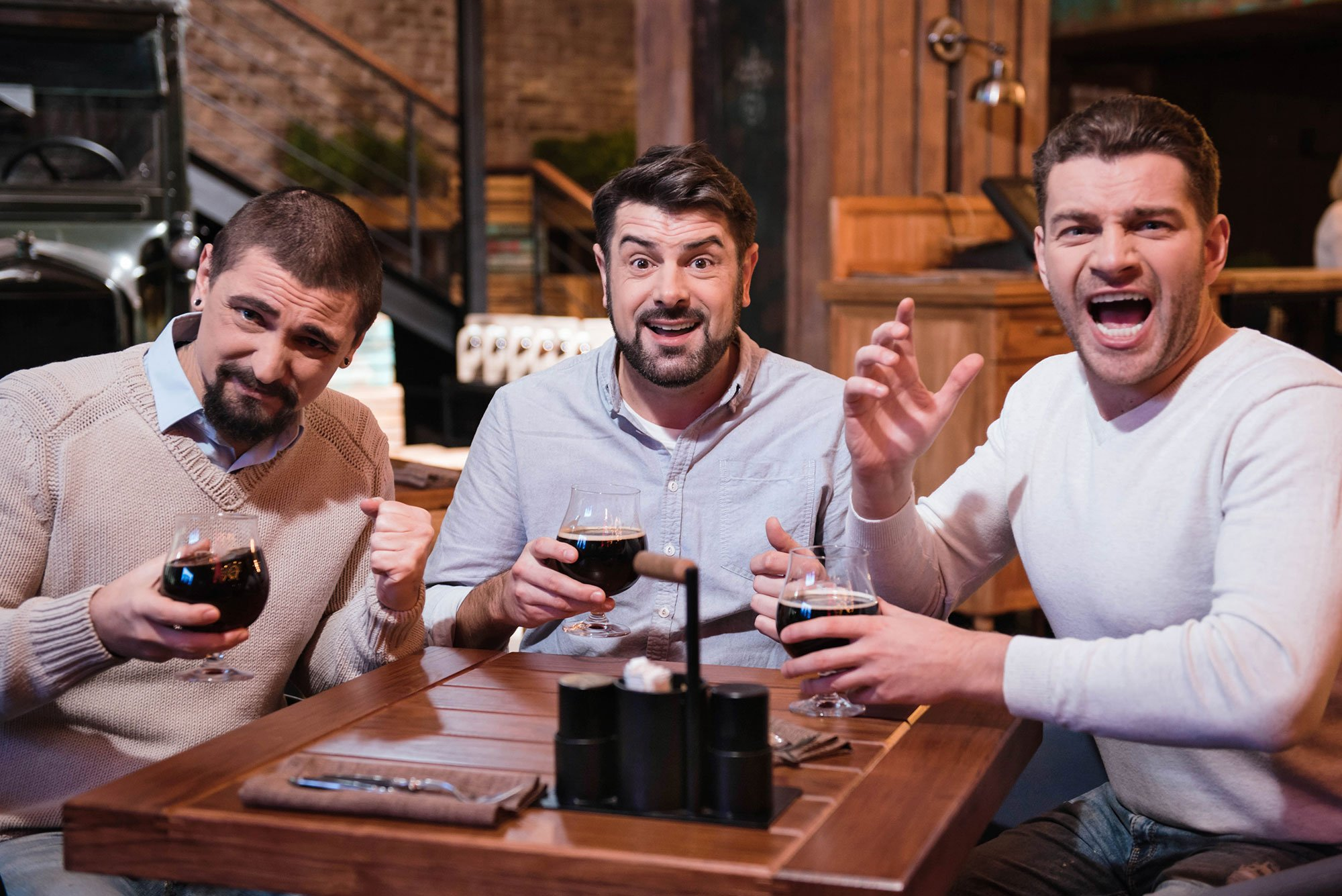 Men playing trivia game