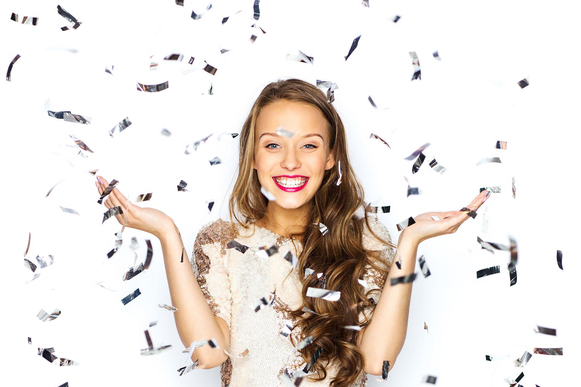 Girl enjoying confetti at her sweet 16 party