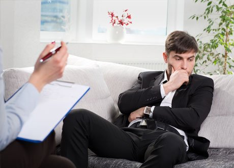 man listening to his lawyer