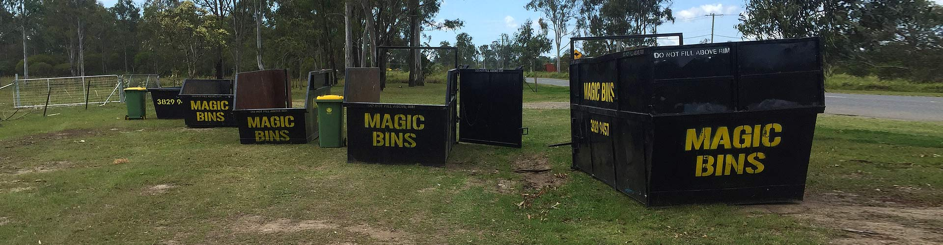 large magic skip bins on grass