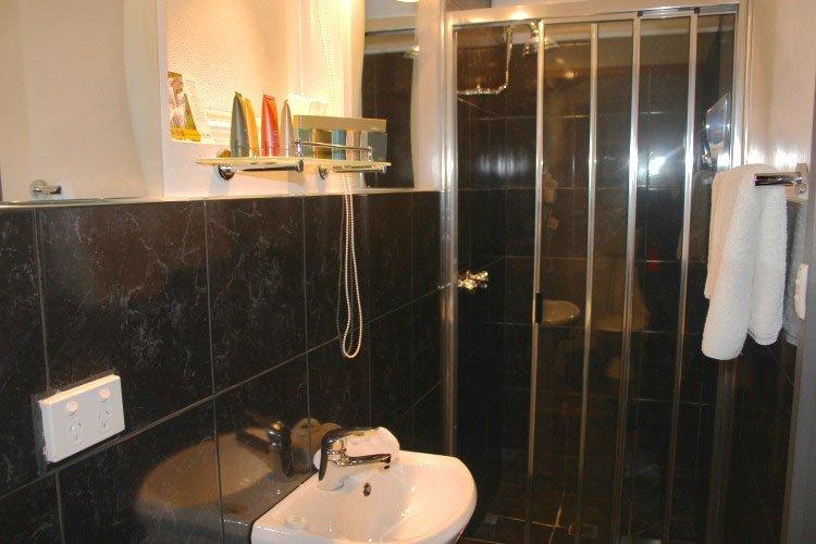 Stylish executive suite bathroom