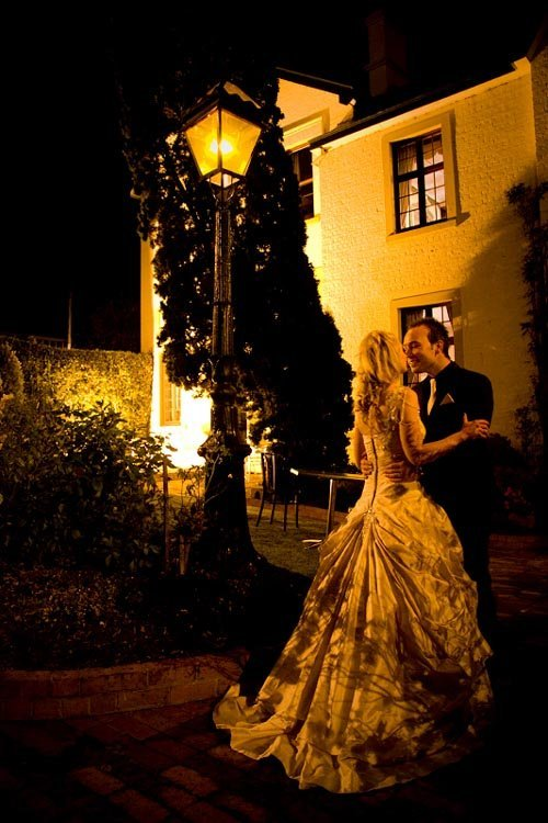 Mr and Mrs Stone in the garden at night