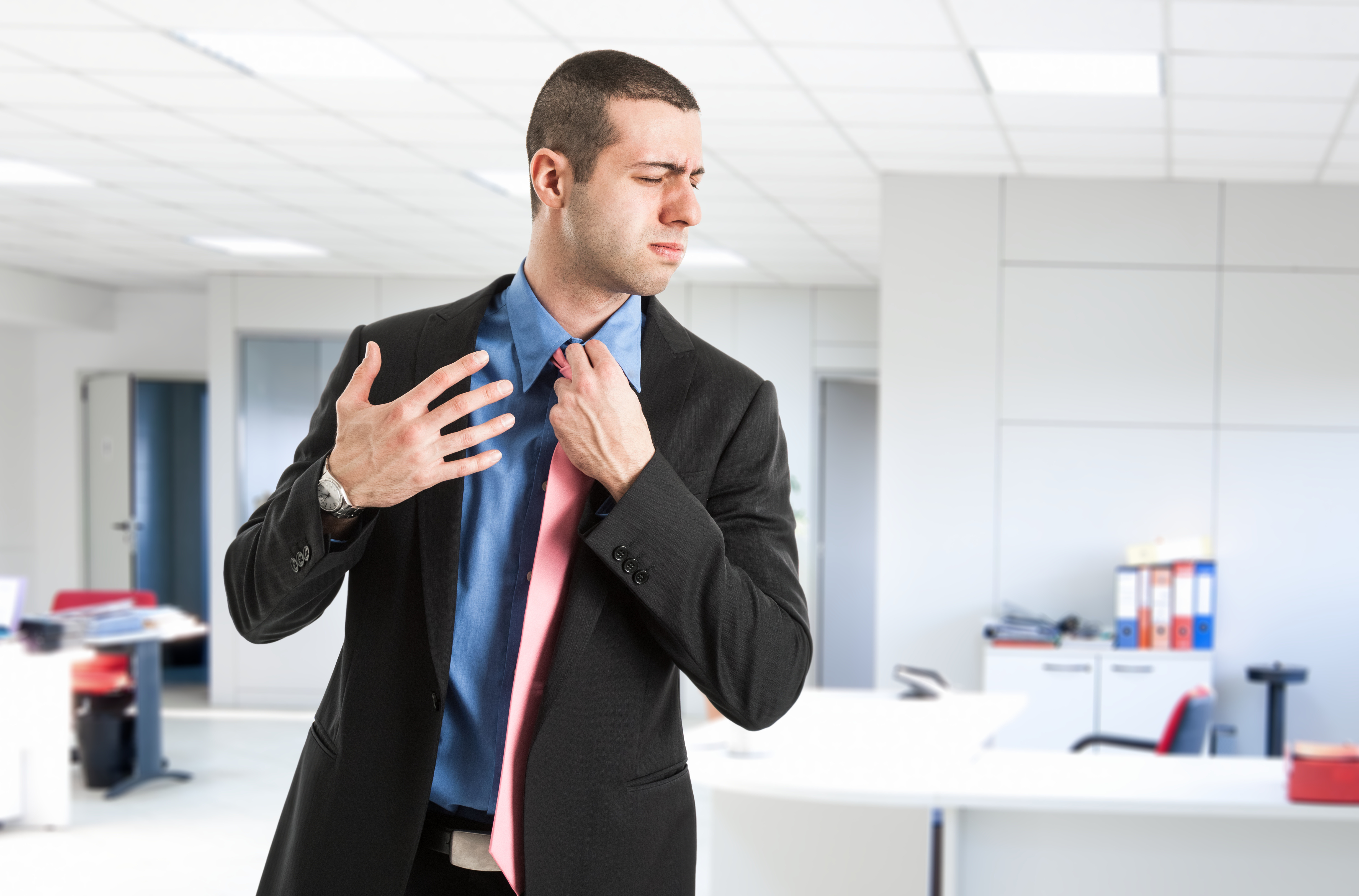 Man in an office where the air conditioner is broken