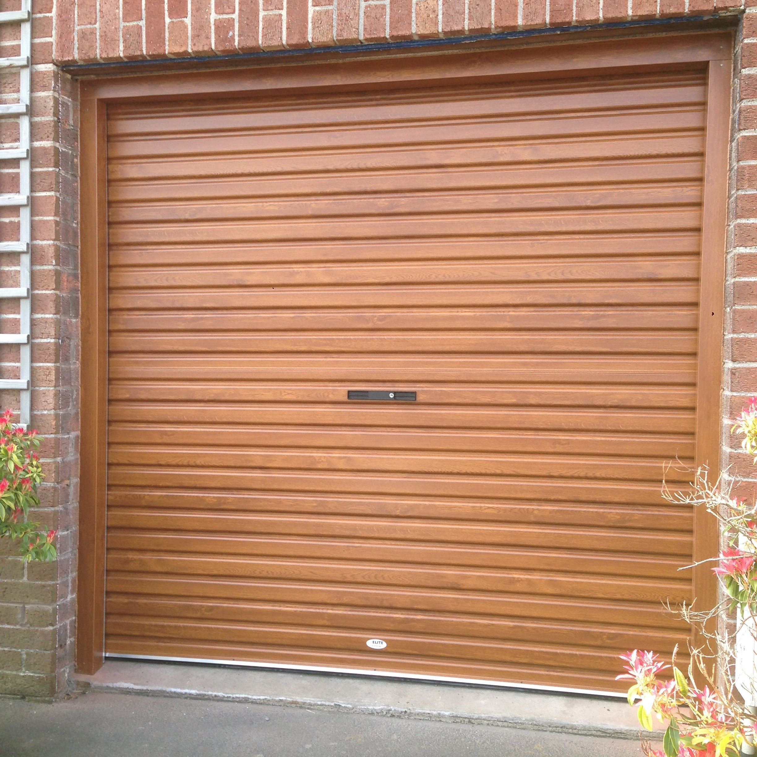 Garage door specialists at elite garage doors in comber for Screen door garage roller door
