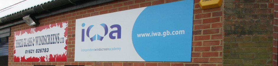 Essex Glass & Windscreens sign next to one for the Independent Windscreen Academy