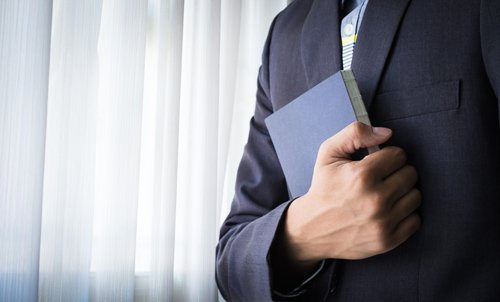 Individual holding the bible to his chest