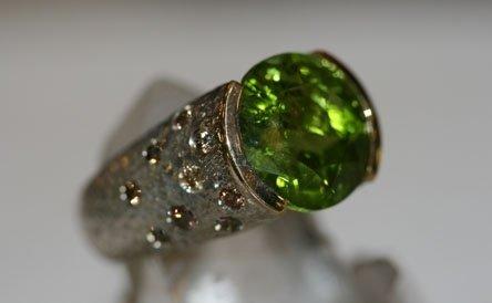 anello argento oro