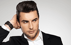 A male model with short brown hair well trimmed