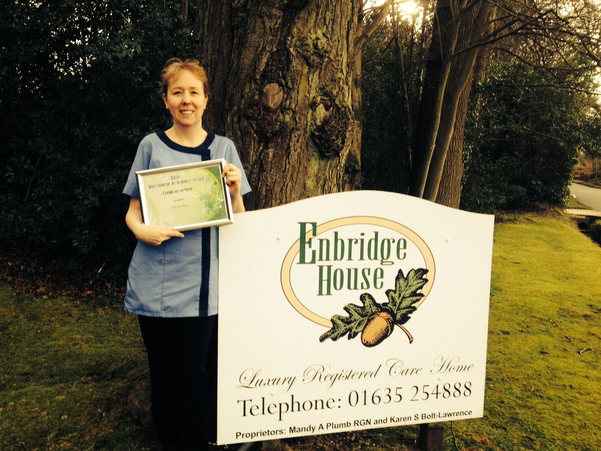 Our manager Claire, holding our certificate of merit