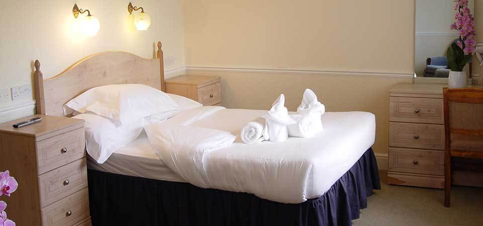 Clean white bed sheets at jasminum