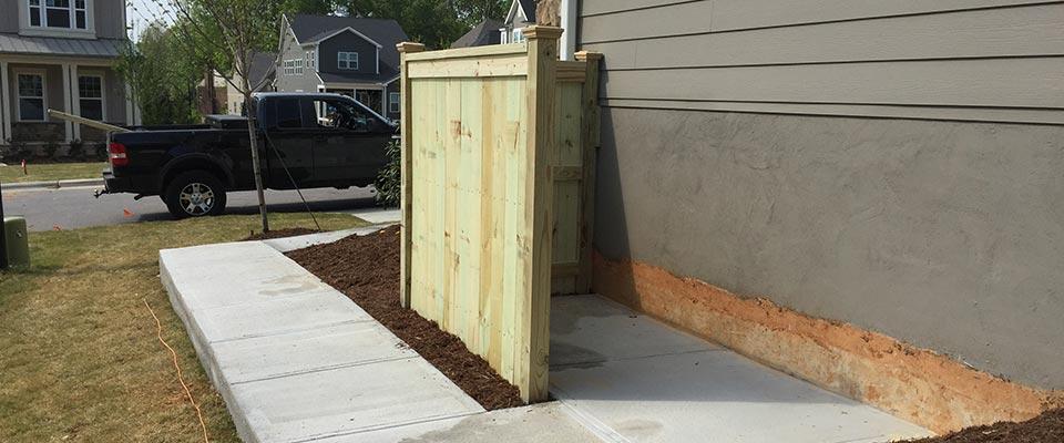 Behind Custom Wood Fence Enclosure