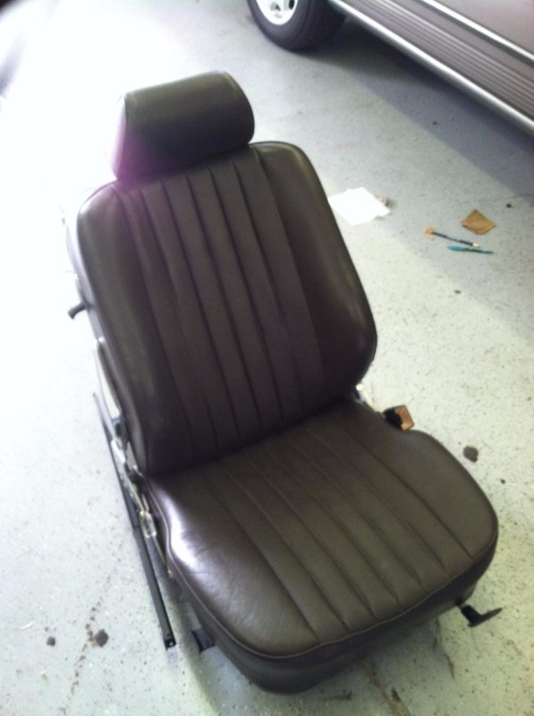 Reupholstered brown leather car seat