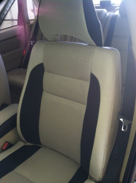 Reupholstered racing seat