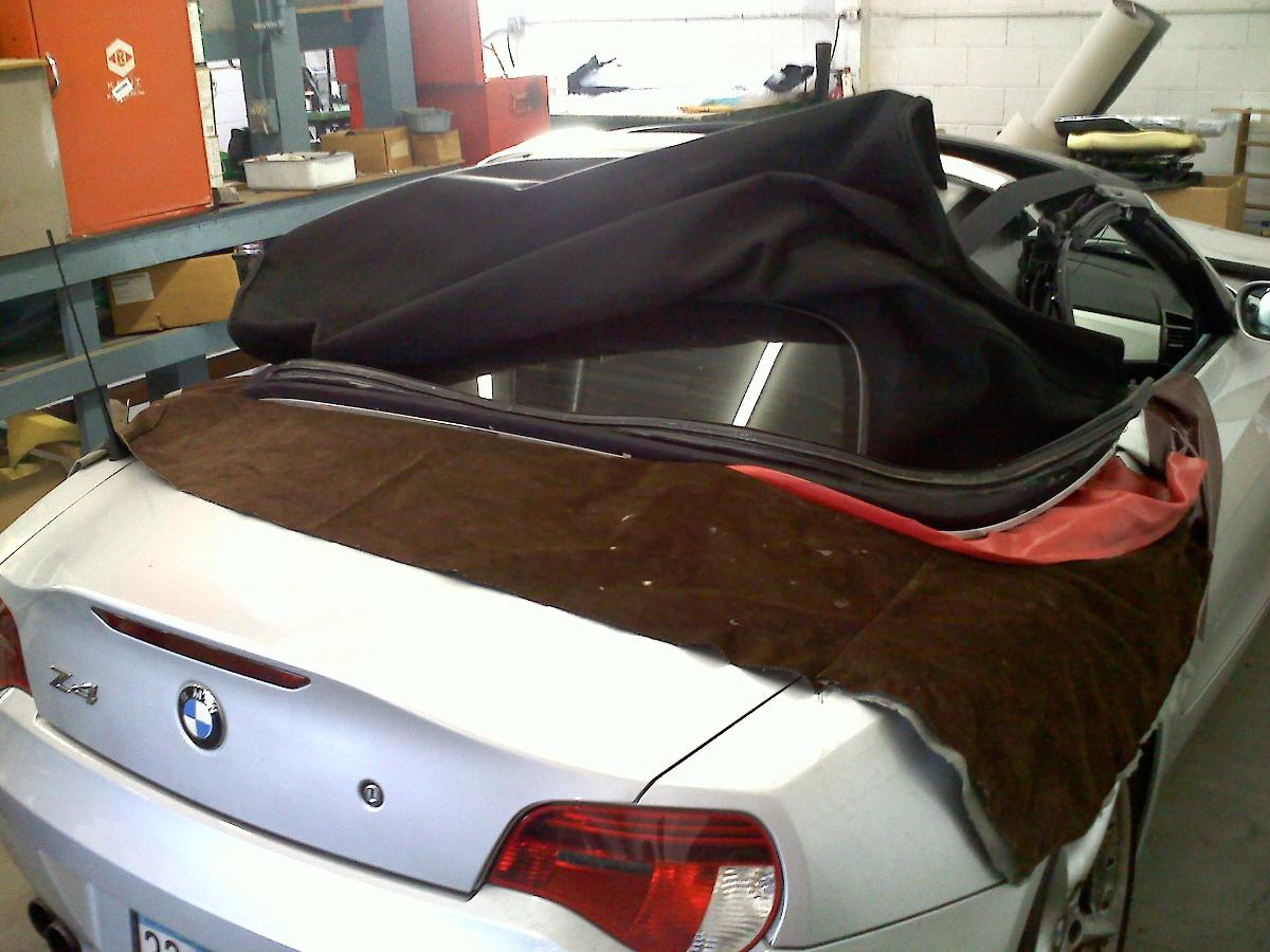 Broken BMW Z4 convertible top needing repair