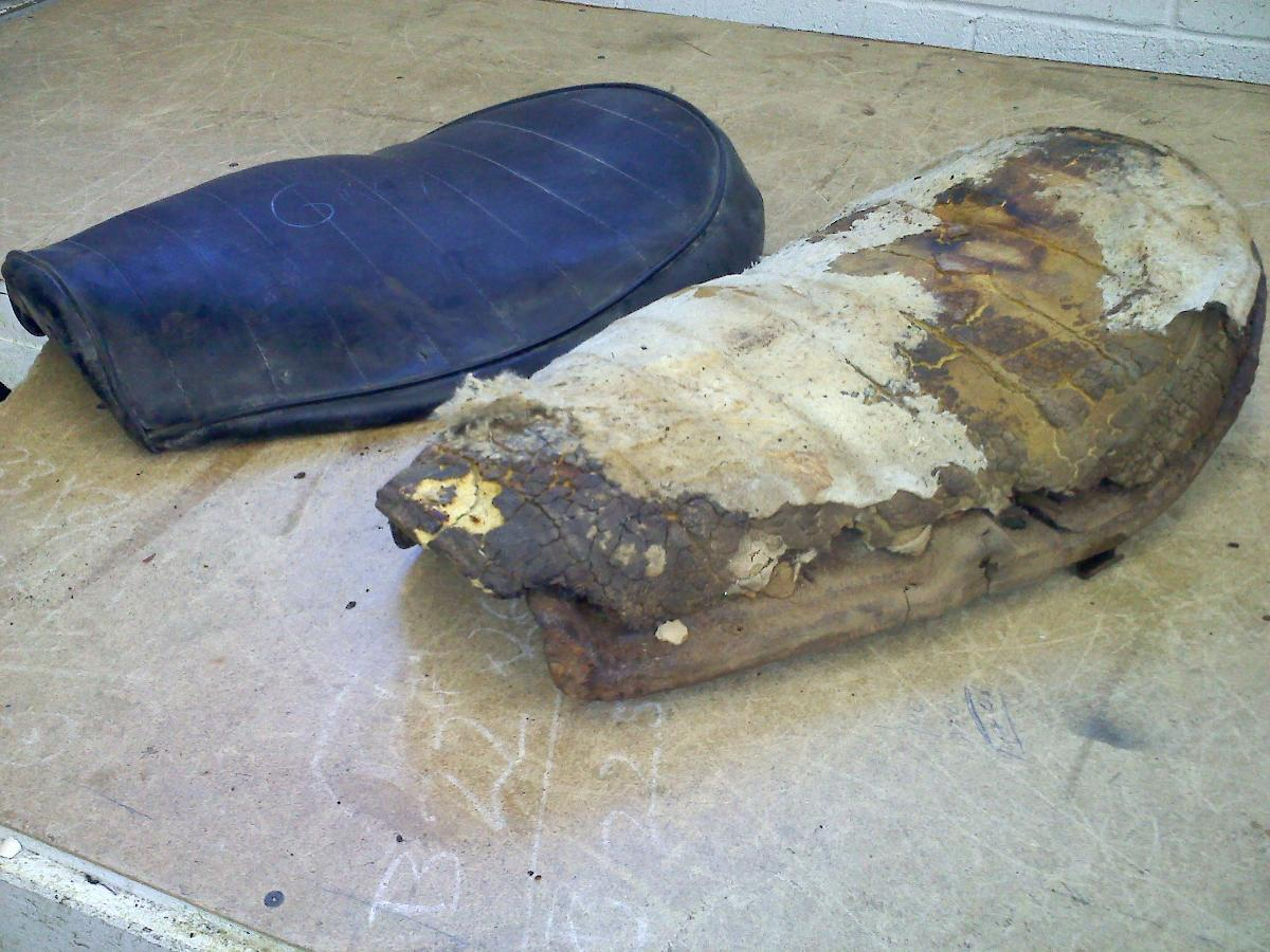 Completely ruined leather motorcycle seat before reupholstery in Santa Fe, NM