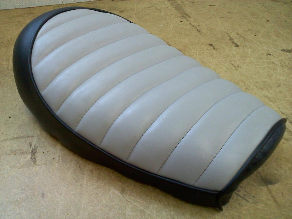 Completely restored leather motorcycle seat after leather upholstery