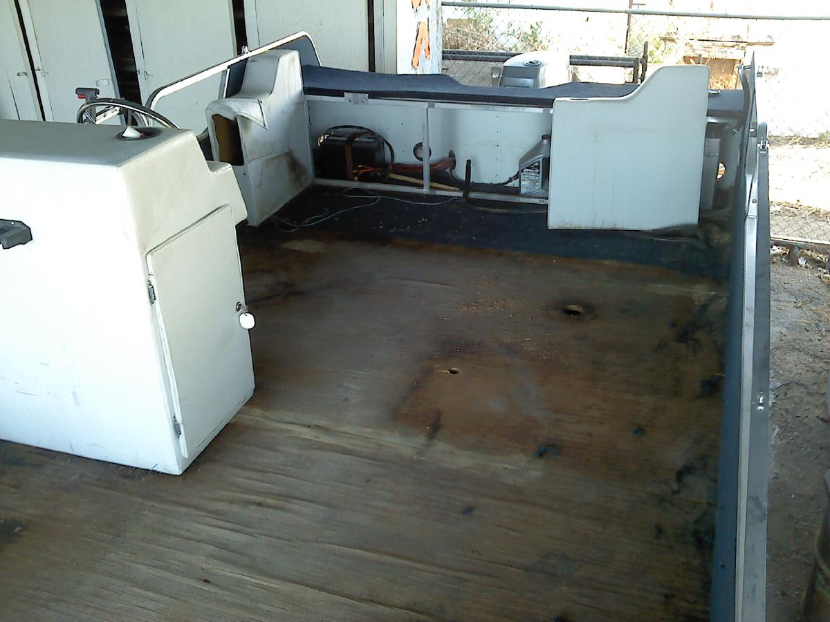 Old torn up boat needing upholstery