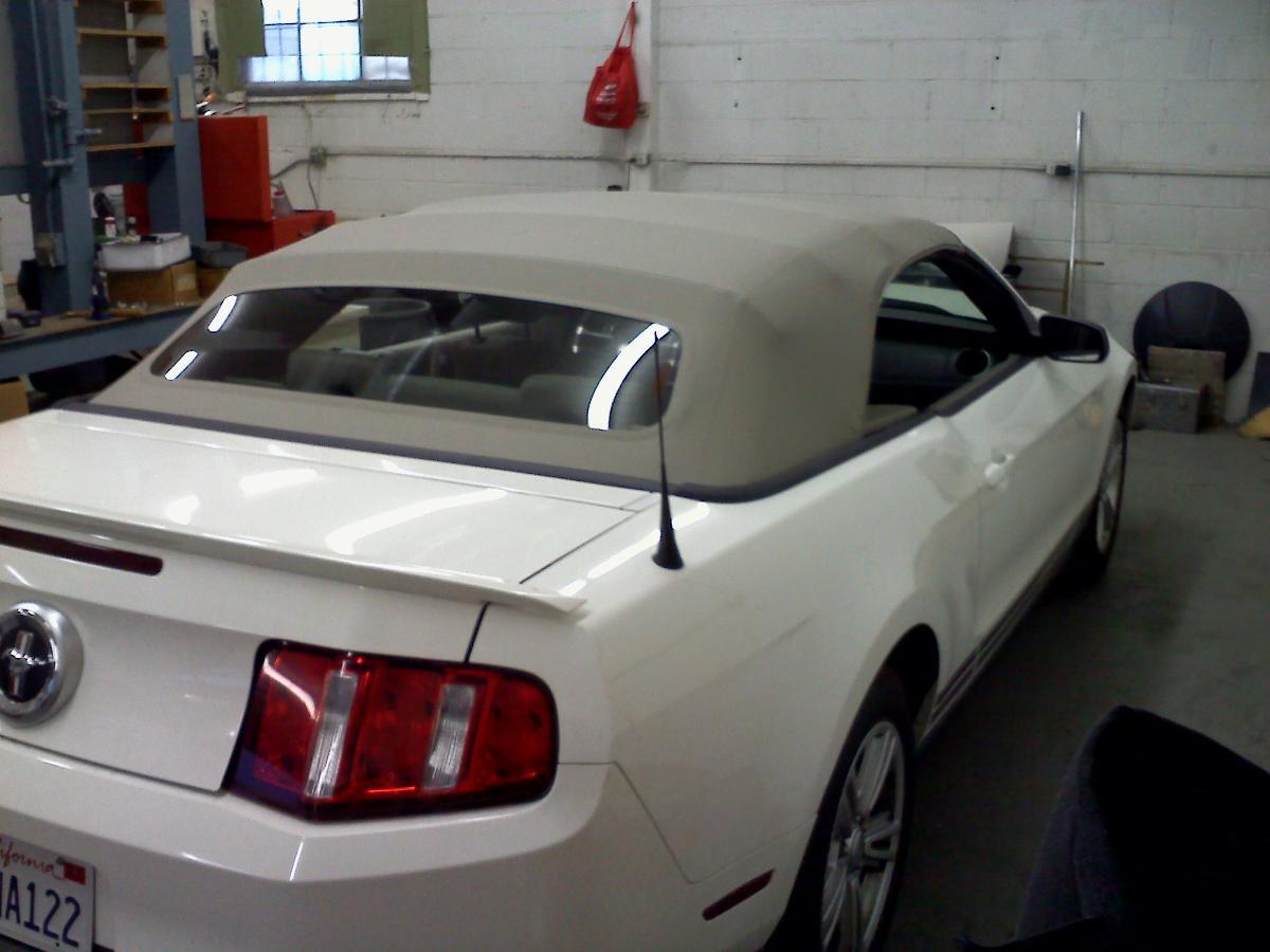 Silver mustang convertible with top repair