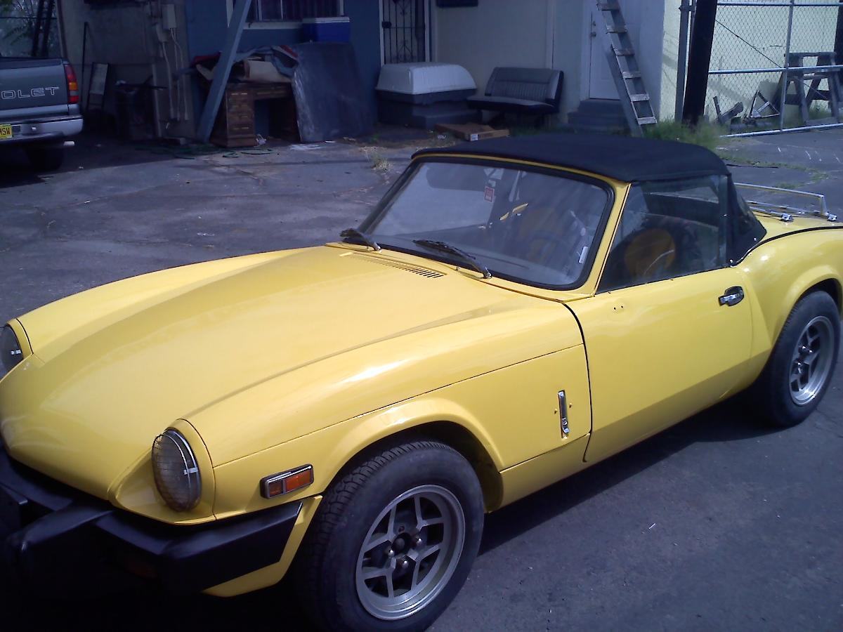 Classic yellow porsche with soft convertible top repair